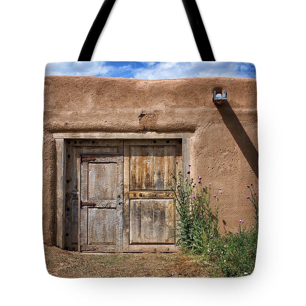 Taos Tote Bag featuring the photograph Puerta Cerrada by Nikolyn McDonald