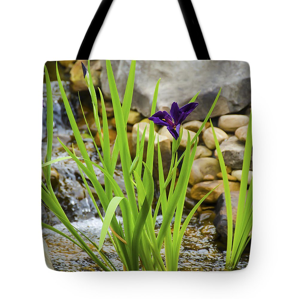 Flowers Tote Bag featuring the photograph Purple Irises Growing In Waterfall by Penny Lisowski