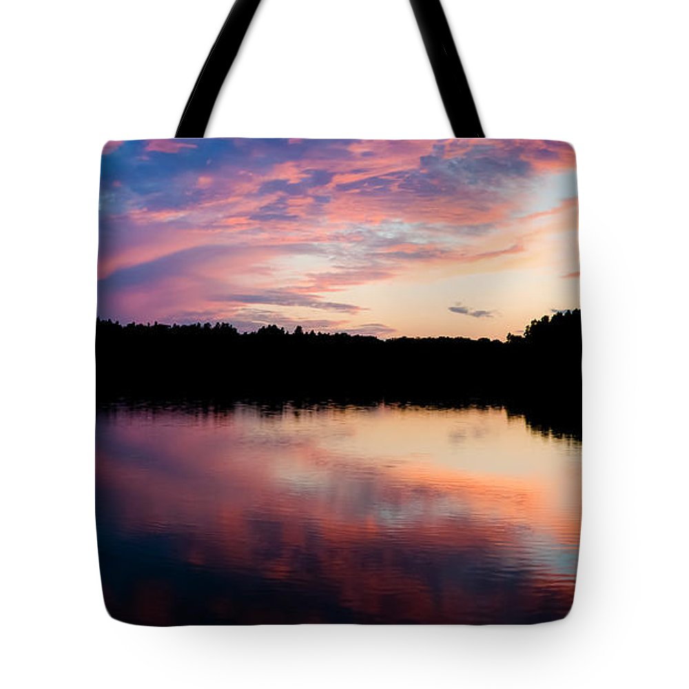 Sunset Tote Bag featuring the photograph Purple Sunset by Yevgeni Kacnelson