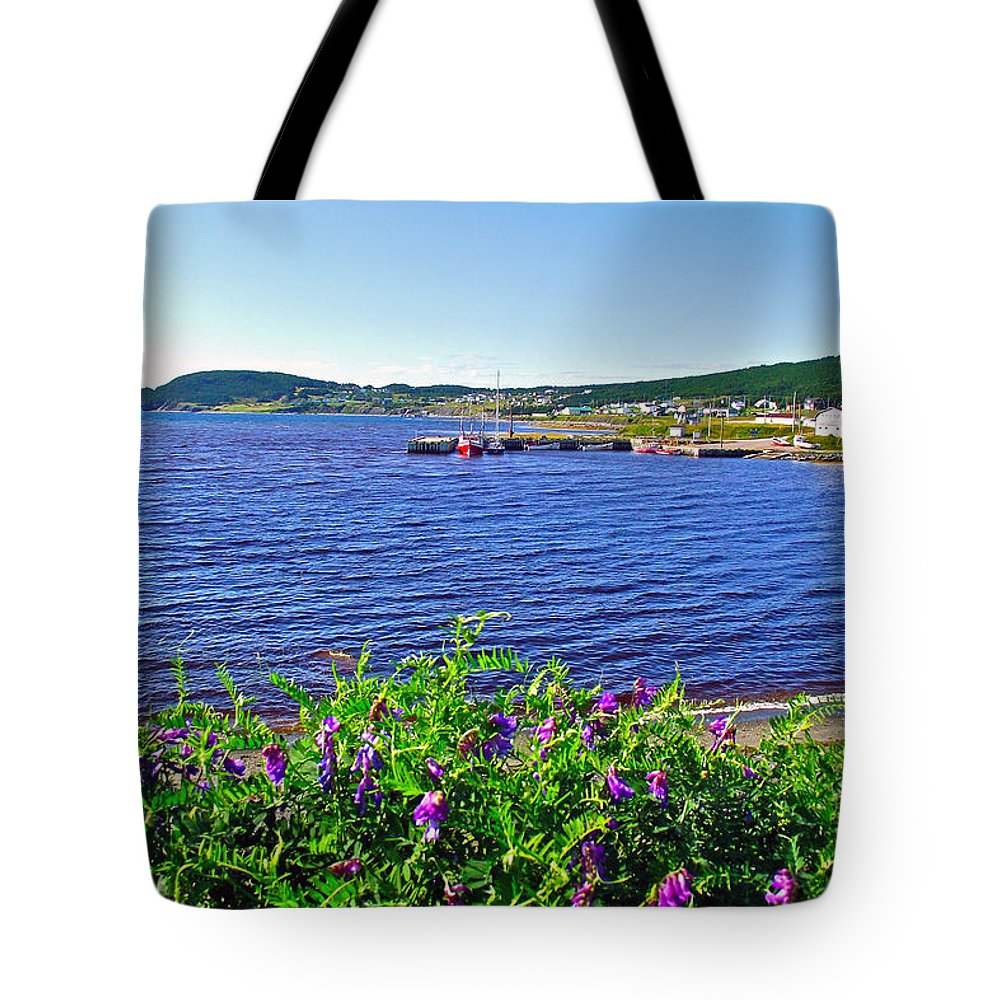 Purple Vetch Overlooking Rocky Harbour In Gros Morne Np Tote Bag featuring the photograph Purple Vetch Overlooking Rocky Harbour-nl by Ruth Hager