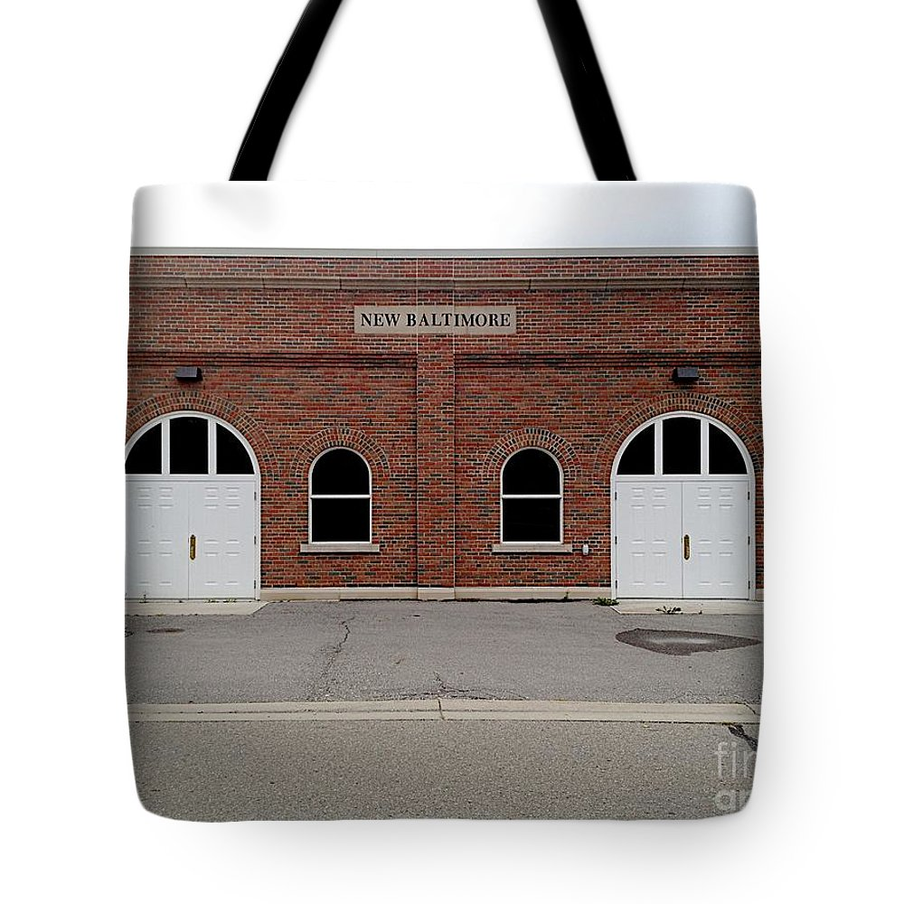 Brick Building Tote Bag featuring the photograph Purpose by Joseph Yarbrough