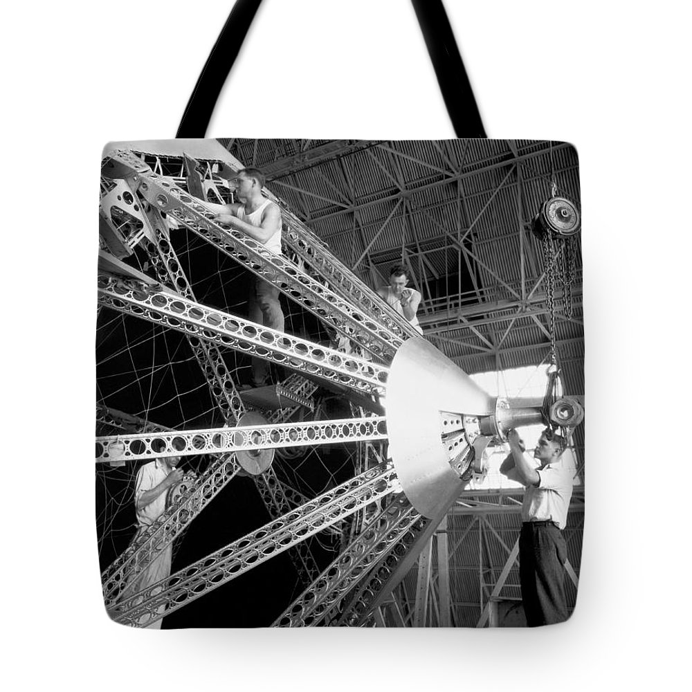 1035-117 Tote Bag featuring the photograph Putting The Nose On The Akron by Underwood Archives