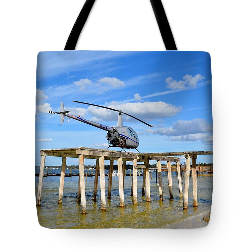 Robinson Tote Bag featuring the photograph R22 On A Dock by Matt Abrams