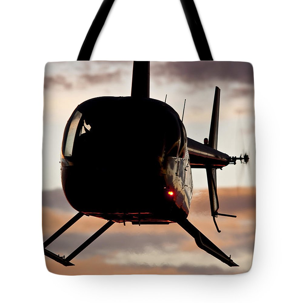 Robinson's R44 Raven 2 Tote Bag featuring the photograph R44 At Sunset by Paul Job