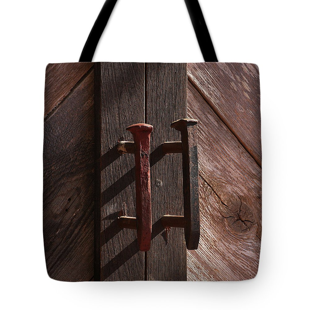 Spike Tote Bag featuring the photograph Railroad Spike Handles by Art Block Collections