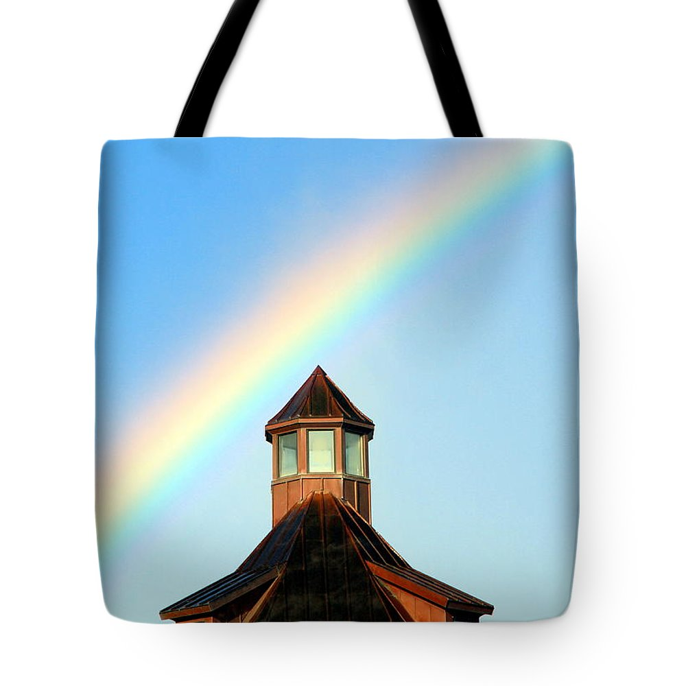 Rainbow Tote Bag featuring the photograph Rainbow Against Blue Sky by Valentino Visentini