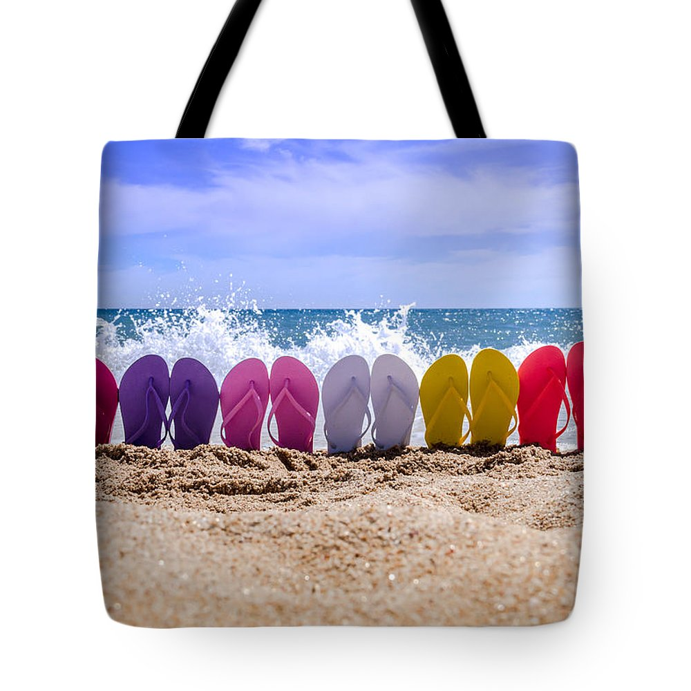 Water Tote Bag featuring the photograph Rainbow Of Flip Flops On The Beach by Teri Virbickis