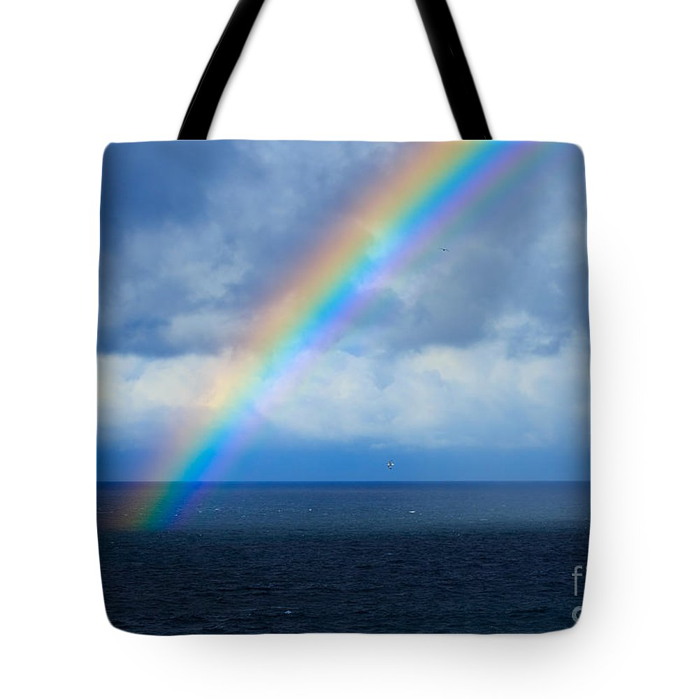 Rainbow Tote Bag featuring the photograph Rainbow Over The Atlantic Ocean by Louise Heusinkveld
