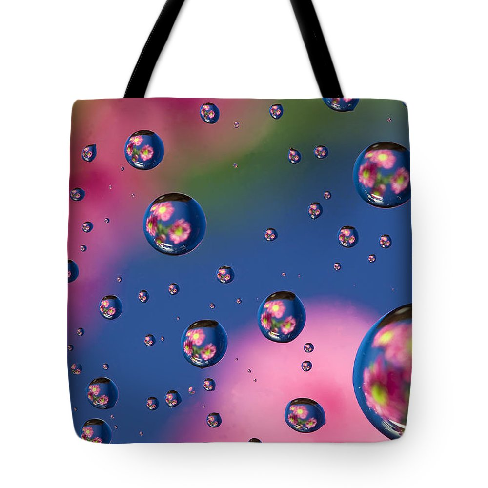 Abstract Tote Bag featuring the photograph Raindrops And Flowers 7 by John Brueske