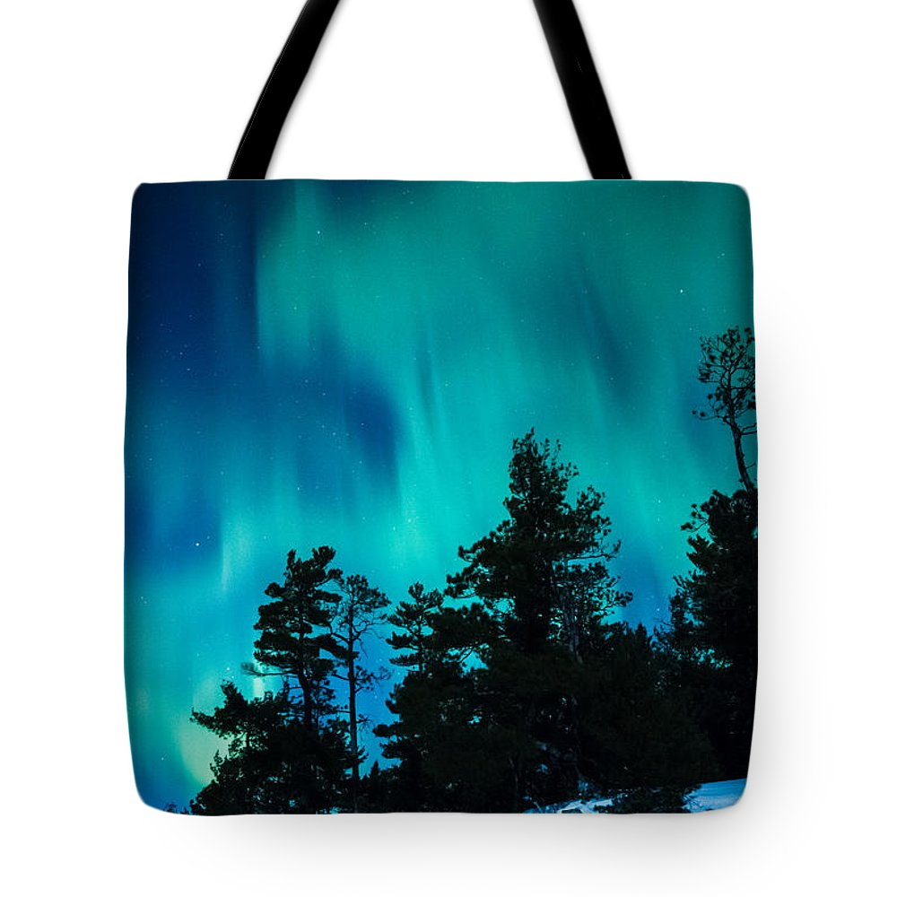 Northern Lights Tote Bag featuring the photograph Rainy Lake Lights by Lori Dobbs