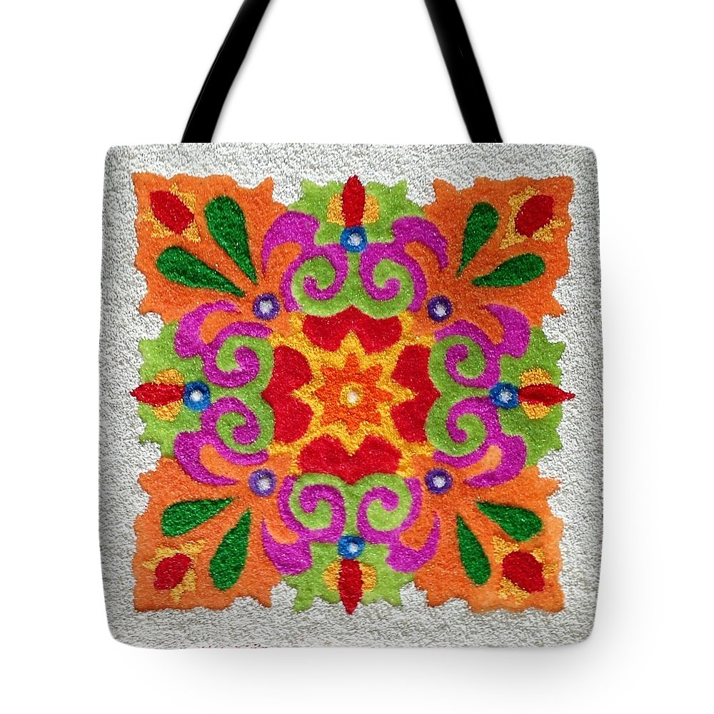 Rangoli Tote Bag featuring the mixed media Rangoli Made With Coloured Sand by Asha Aditi Ruparelia