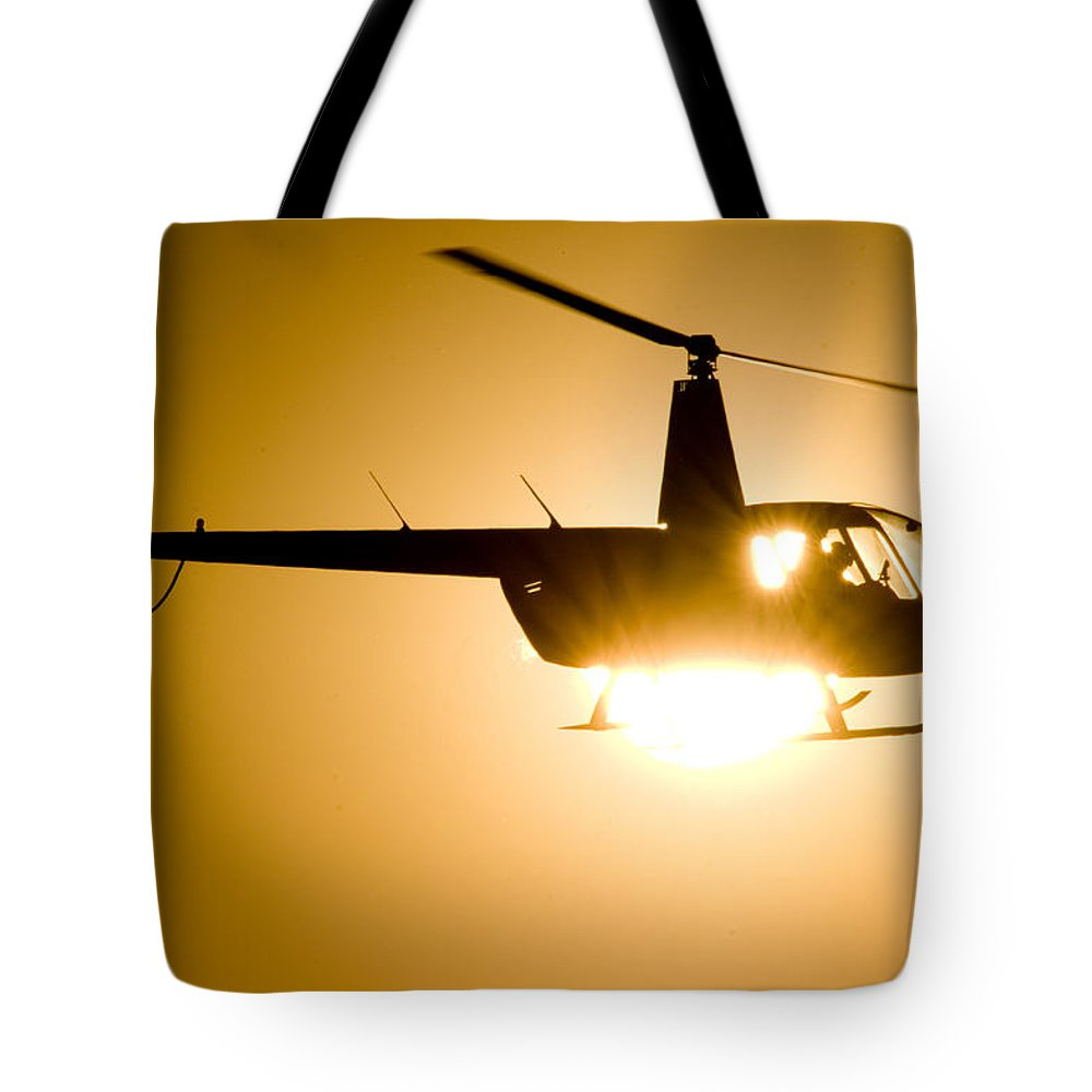 Robinson R44 Raven Ii Tote Bag featuring the photograph Raven Sun by Paul Job