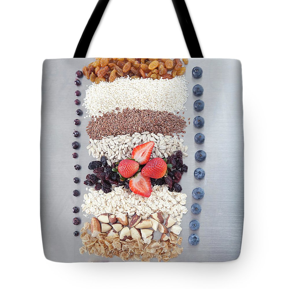 Nut Tote Bag featuring the photograph Raw Nuts, Fruit And Grains by Laurie Castelli