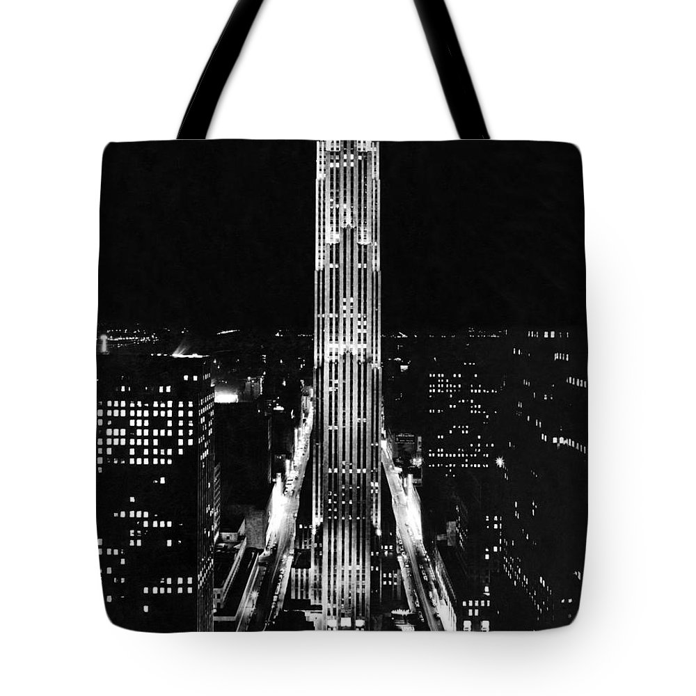 1938 Tote Bag featuring the photograph Rca Building At Night In Nyc by Underwood Archives