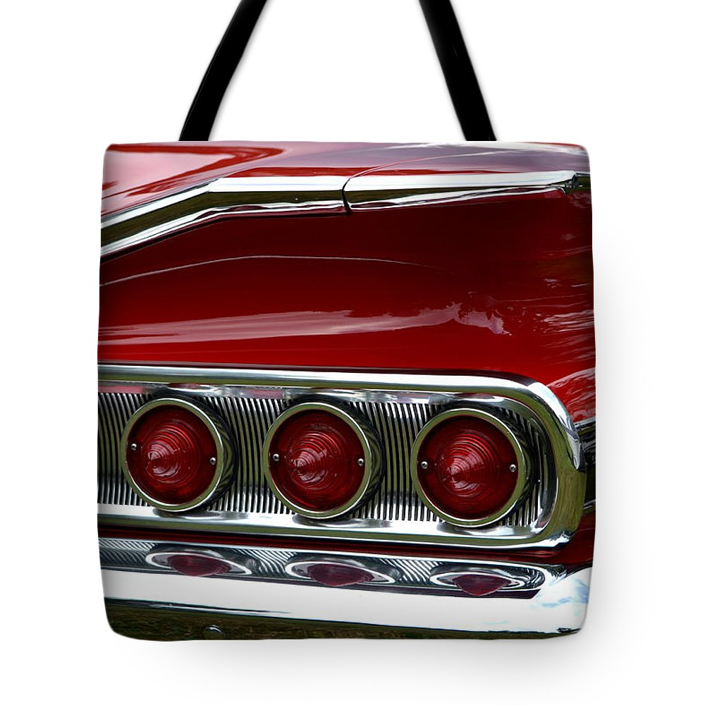 Tote Bag featuring the photograph Red 1960 Chevy Tail Light by Dean Ferreira