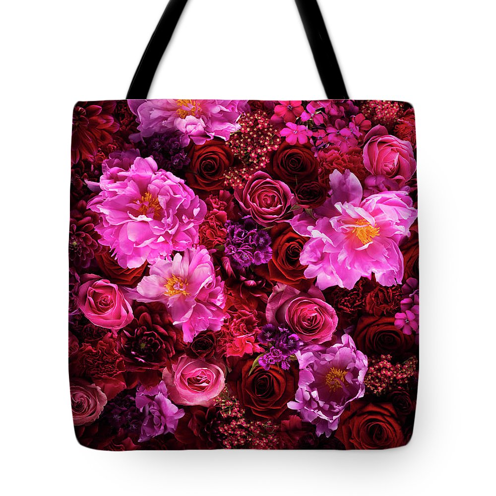 Tranquility Tote Bag featuring the photograph Red And Pink Cut Flowers, Close Up by Jonathan Knowles