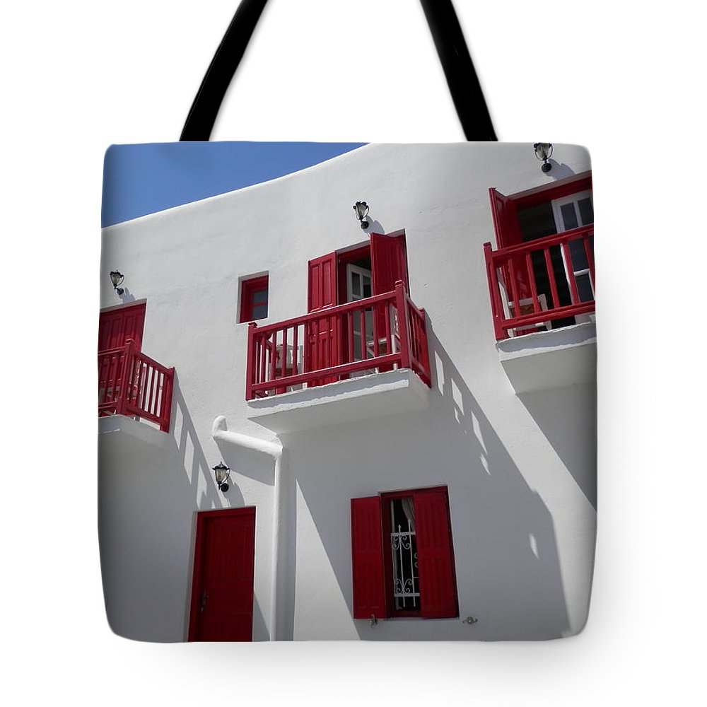 Red Tote Bag featuring the photograph Red And White In Mykonos by Pema Hou