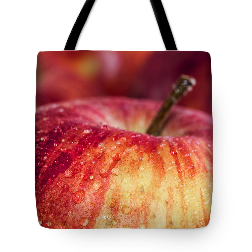 Red Tote Bag featuring the photograph Red Apple by Paulo Goncalves