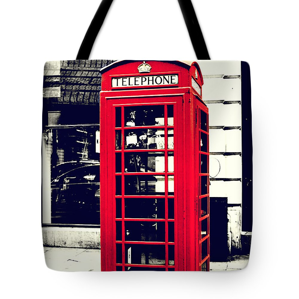 Red Tote Bag featuring the photograph Red British Telephone Booth by Joan McCool