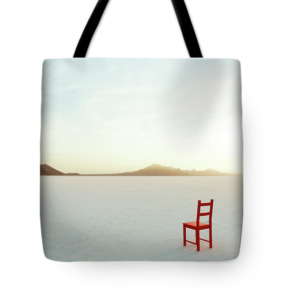Tranquility Tote Bag featuring the photograph Red Chair On Salt Flats, Facing The by Andy Ryan