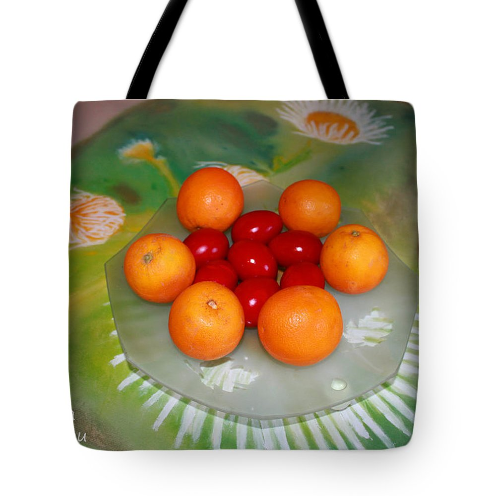 Augusta Stylianou Tote Bag featuring the photograph Red Eggs And Oranges by Augusta Stylianou