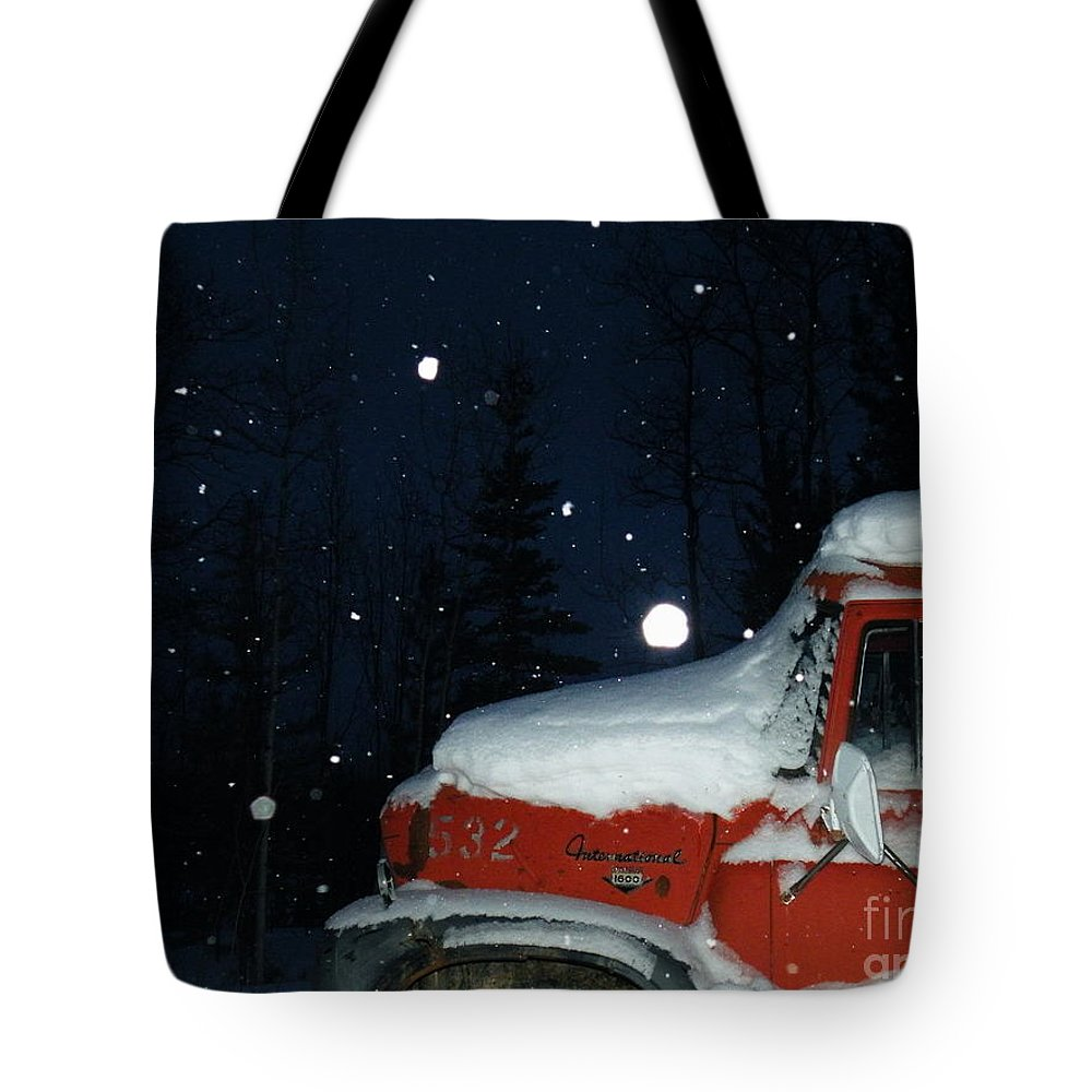 Red Tote Bag featuring the photograph Red International Singing Those Deep Winter Blues by Brian Boyle