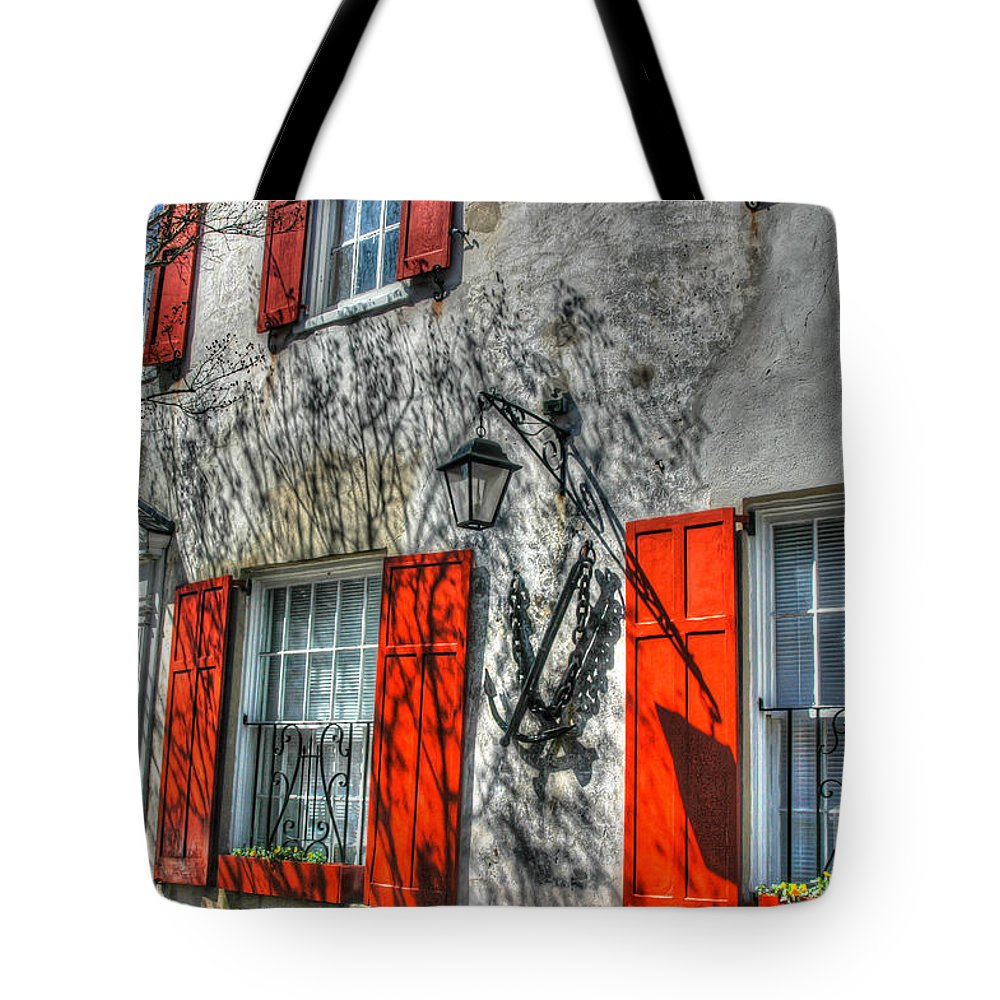 Red Shutters Tote Bag featuring the photograph Pirate House by Dale Powell