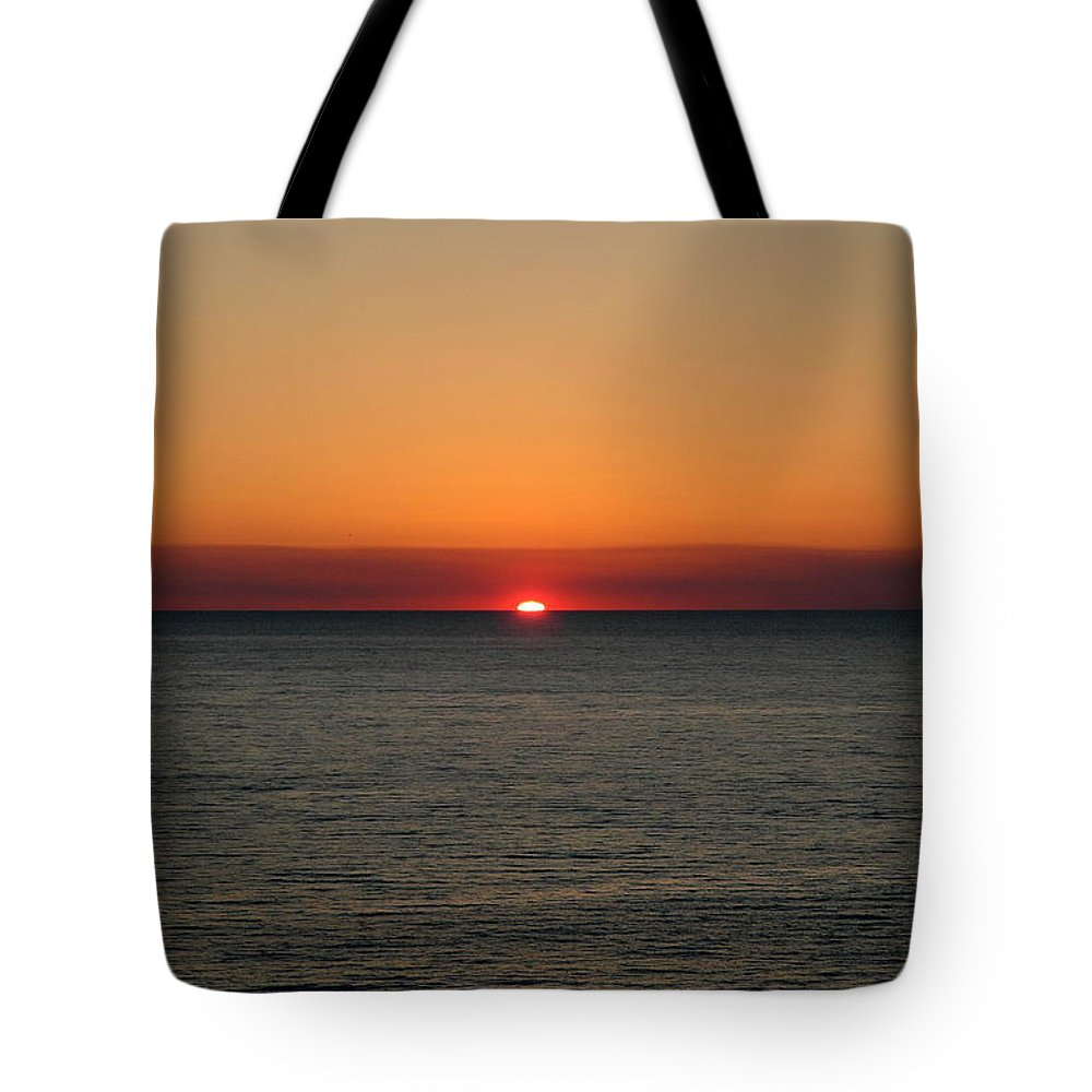 Beach Tote Bag featuring the photograph Red Sky At Night by Roe Rader