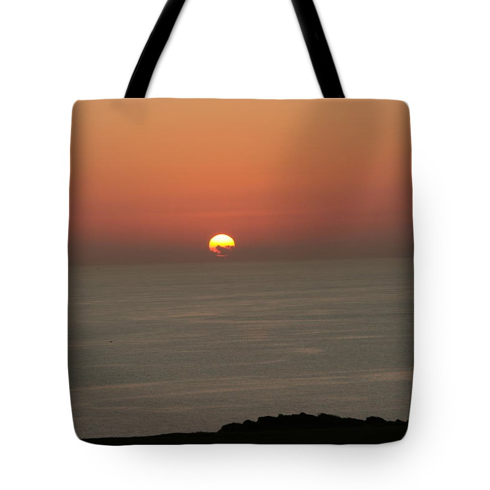 Red Sunset Over Sea Tote Bag featuring the photograph Red Sunset Over Sea by Gordon Auld