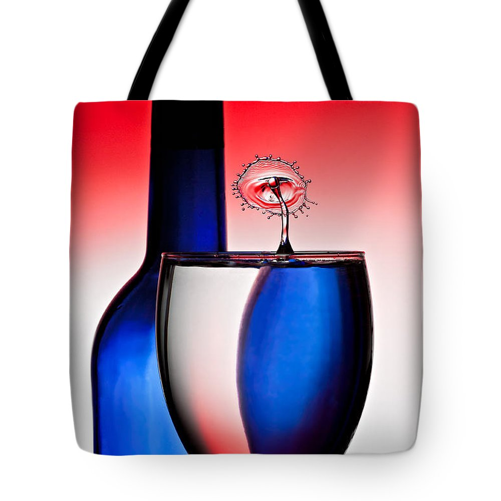 Water Tote Bag featuring the photograph Red White And Blue Reflections And Refractions by Susan Candelario