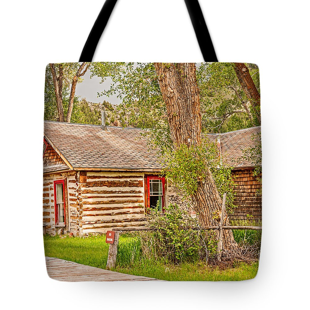 Bannack Tote Bag featuring the photograph Red Windows by Sue Smith