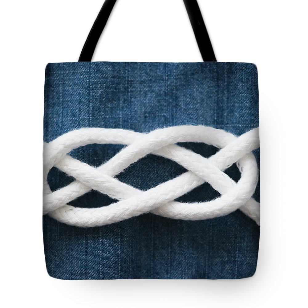 Security Tote Bag featuring the photograph Reef Knot by Jamie Grill