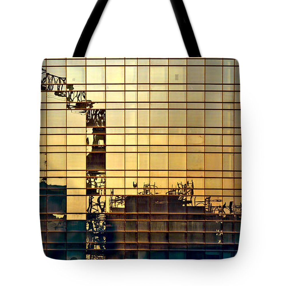 Architecture Tote Bag featuring the photograph Reflected Cranes At Sunset by Roberto Pagani