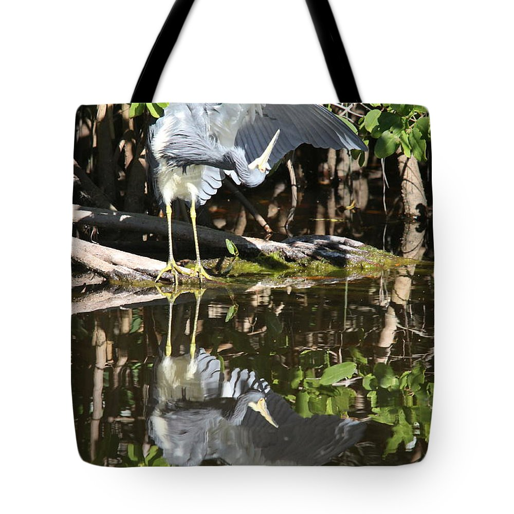 Greta Blue Heron Tote Bag featuring the photograph Reflected Great Blue Heron by Christiane Schulze Art And Photography