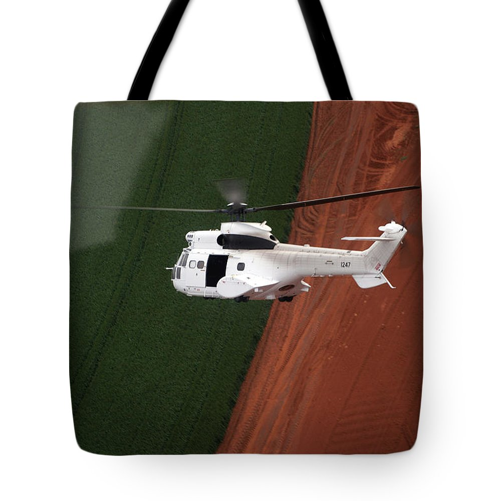 Reflection Tote Bag featuring the photograph Reflective Helicopter by Paul Job