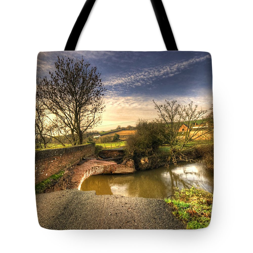 Westcott Tote Bag featuring the photograph Remains Of The Bridge by Rob Hawkins