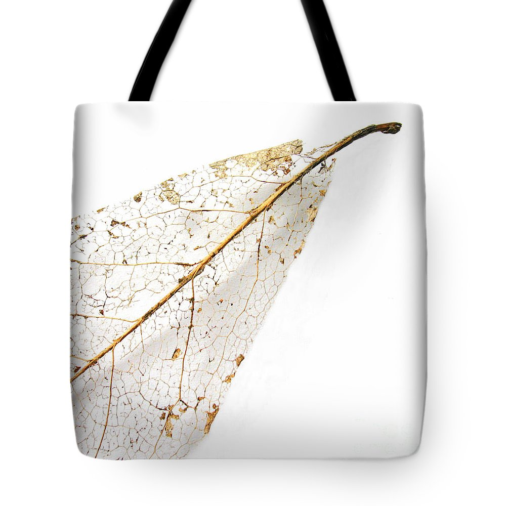 Leaf Tote Bag featuring the photograph Remnant Leaf by Ann Horn