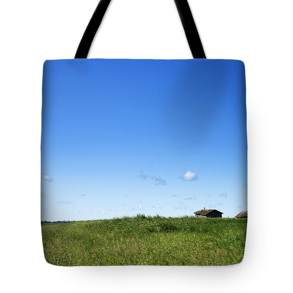 Prairie Tote Bag featuring the photograph Remote Prairie Landscape With Abandoned Buildings by Donald Erickson