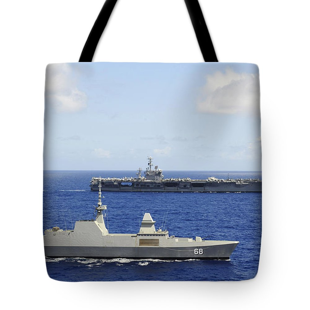 Military Tote Bag featuring the photograph Republic Of Singapore Frigate Rss by Stocktrek Images