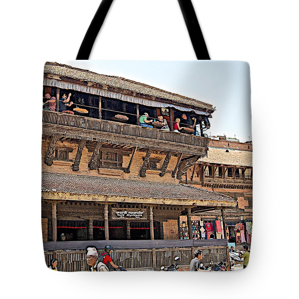 Restaurant In Bhaktapur Durbar Square In Bhaktapur In Nepal Tote Bag featuring the photograph Restaurant In Bhaktapur Durbar Square In Bhaktapur-nepal by Ruth Hager