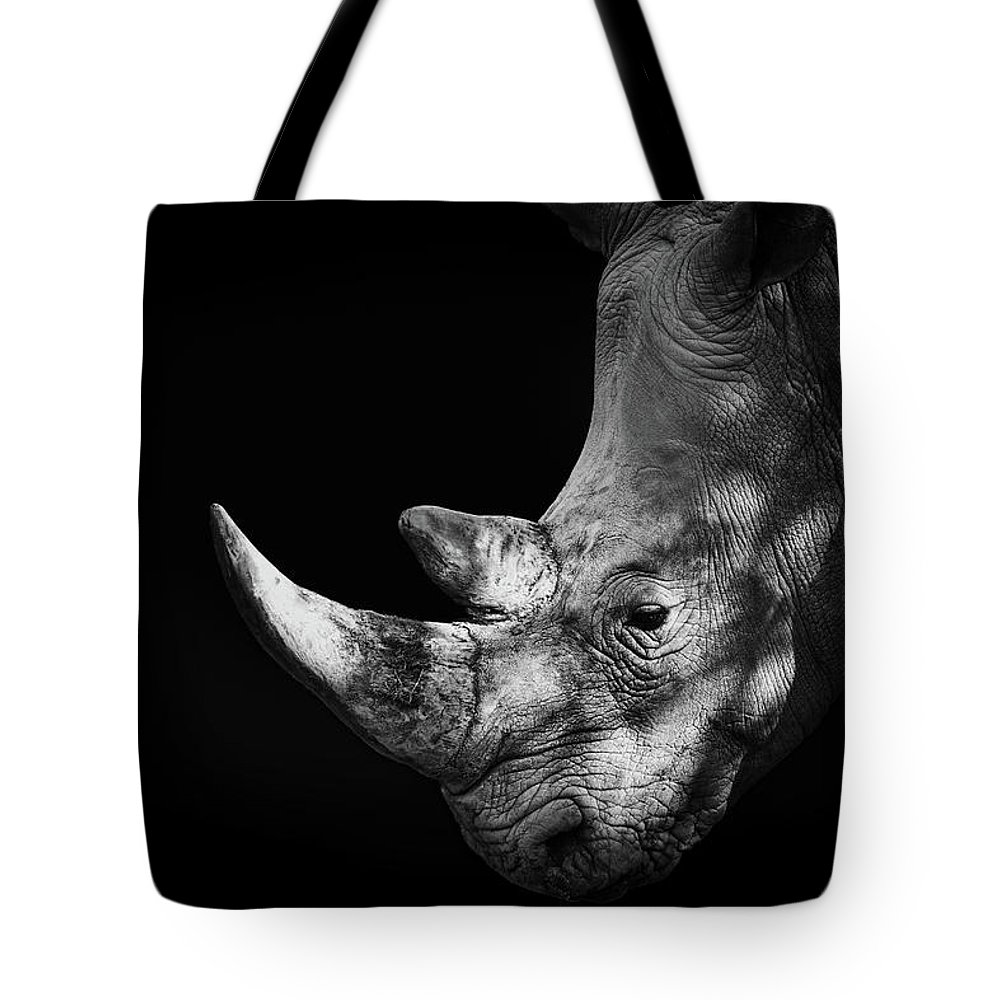 Horned Tote Bag featuring the photograph Rhinoceros by Malcolm Macgregor