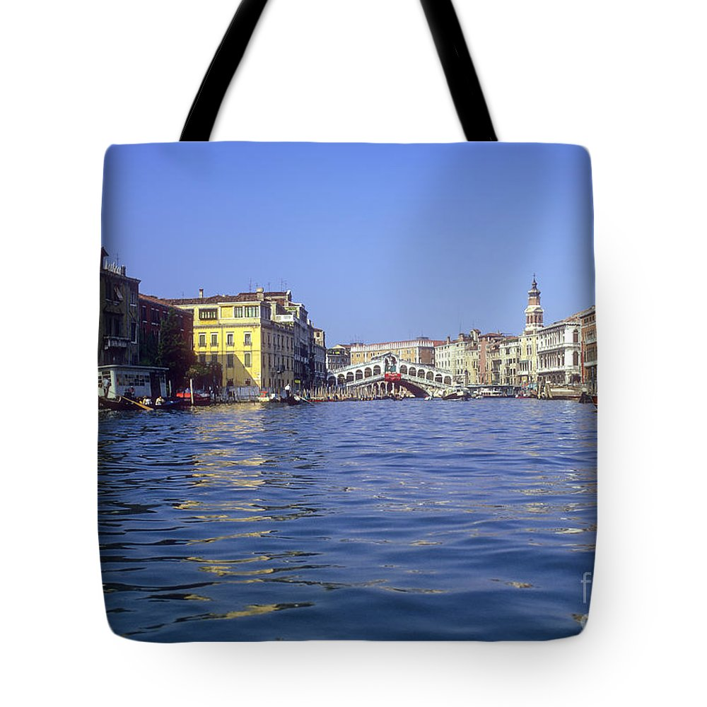 Rialto Bridge Venice Grand Canal Canals Building Buildings Structure Structures Architecture Water Boat Boats Bridges Church Churches Gondola Gondolas City Cities Cityscape Cityscapes Italy Tote Bag featuring the photograph Rialto Bridge In The Grand Canal by Bob Phillips