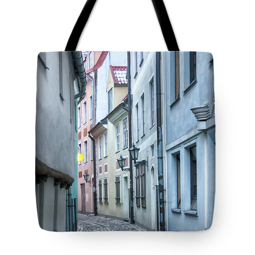 Latvia Tote Bag featuring the photograph Riga Narrow Street by Antony McAulay