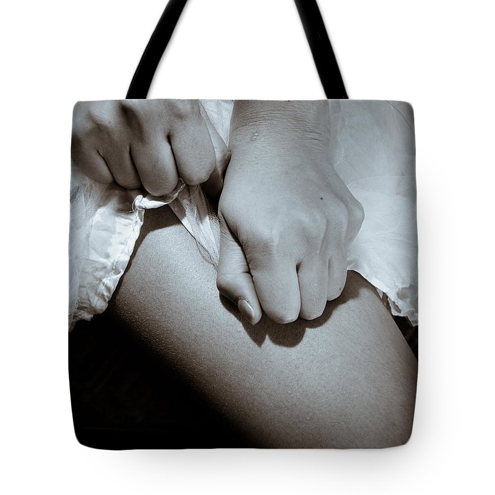 Conflict Tote Bag featuring the photograph Ripping Skirt by Scott Sawyer