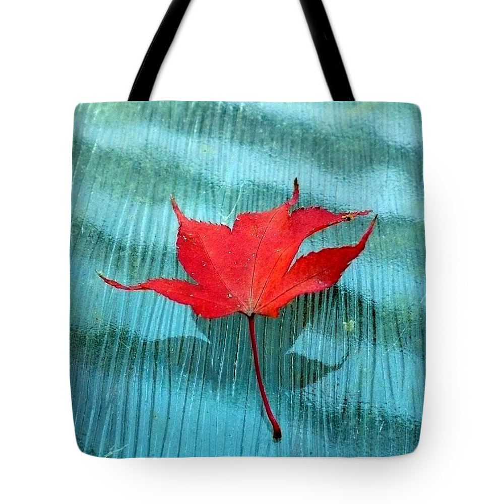 Red Tote Bag featuring the photograph Rippling Red by Nicki Bennett