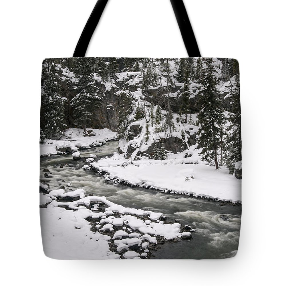 Yellowstone National Park Tote Bag featuring the photograph River Flow One by Bob Phillips