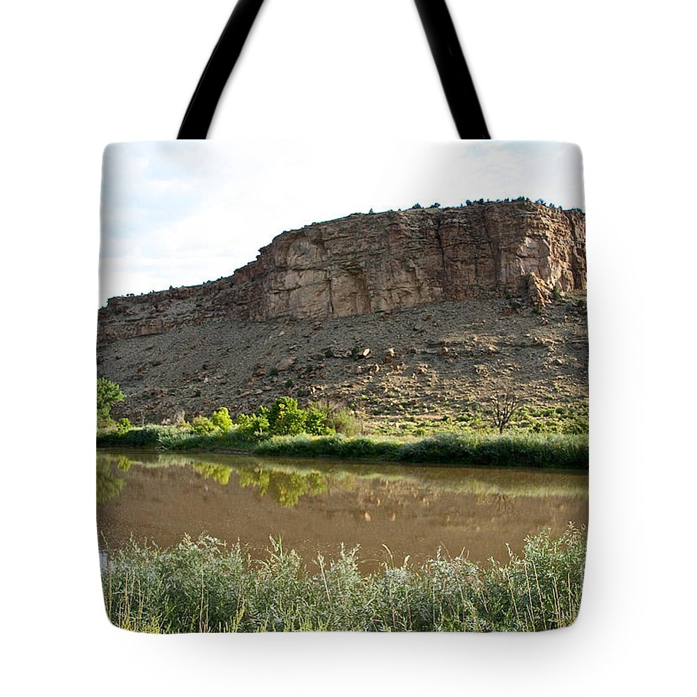 Outdoors Tote Bag featuring the photograph River's Rough Bluff by Susan Herber