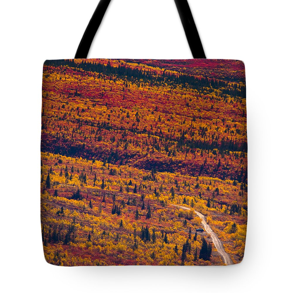 Adventure Tote Bag featuring the photograph Road Through Fall Colored Tundra by Stephan Pietzko