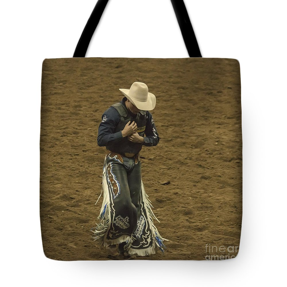 Rodeo Tote Bag featuring the photograph Rodeo Cowboy Dusting Off by Janice Pariza