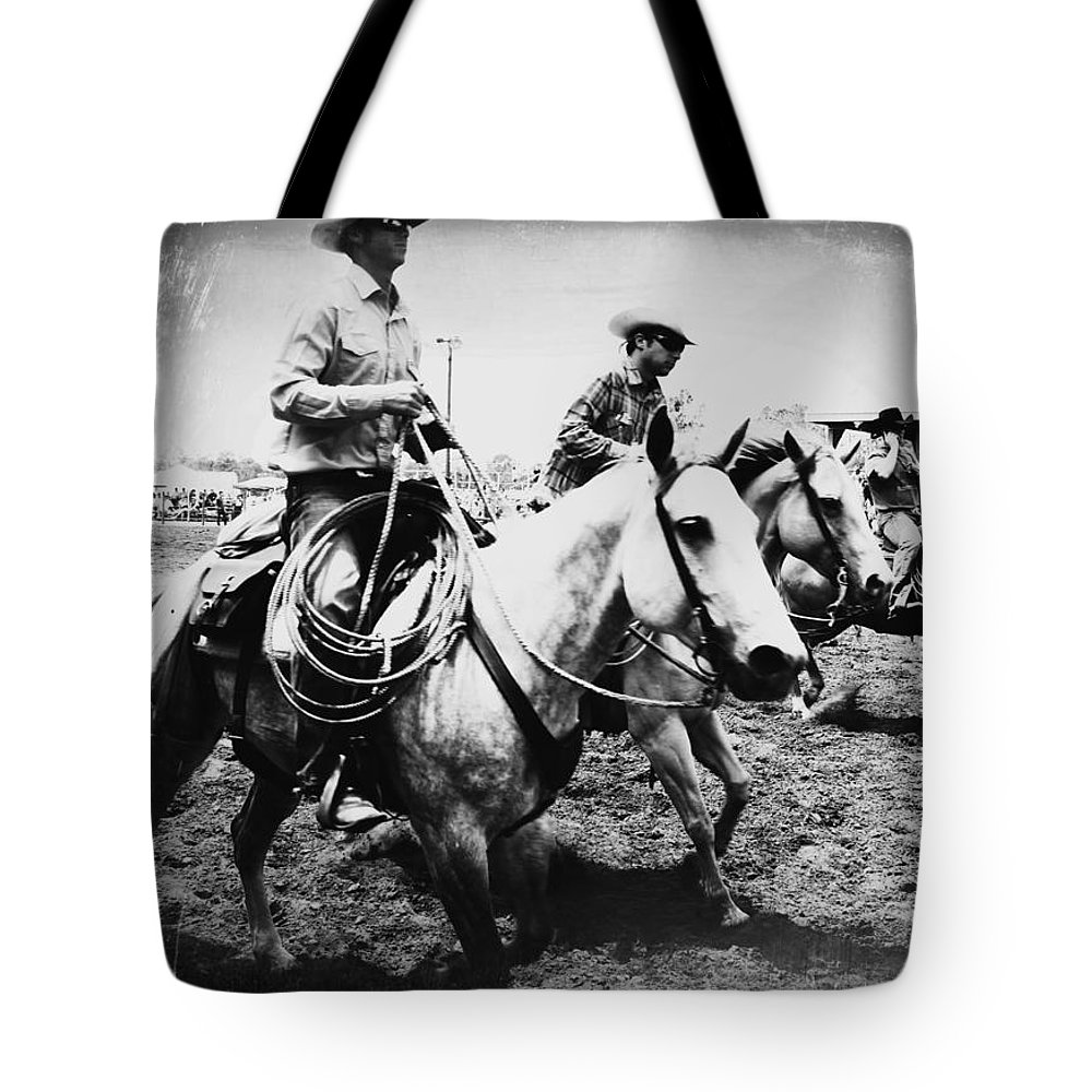 Rodeo Cowhands Cowboys Horses Tote Bag featuring the photograph Rodeo Men by Alice Gipson